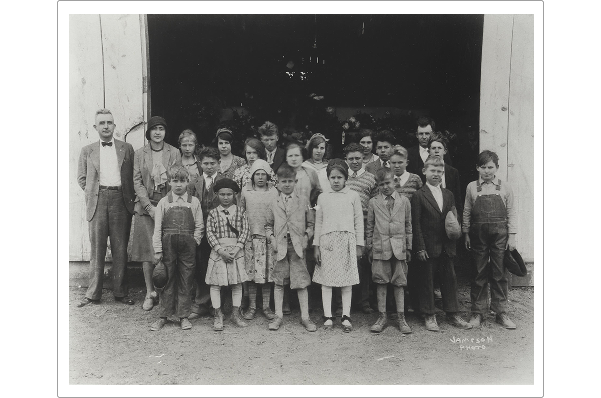 Students from the Hoover School standing in front of the flower tent at the Madison County Fair. Miss Vest, the teacher, is second from the left in the back row. The girl who inspired the character of April Sloane stands just to the right of Miss Vest.